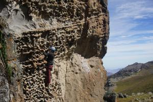Ana climbing the route 'Brian' (6a+/5.10c) at Hatun Machay.
