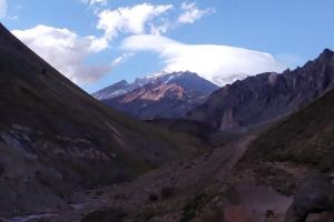 Aconcagua on the distance, the giant lenticular mushroom cloud on covering its peak all day.