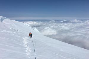 "Finally on the summit ice cap, above the ""secret passage"""