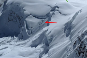 serac and debris from serac falling over the next day (red) and our camp (green arrow)