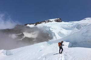 Eddie switching back into glacier travel mode after we rappelled over the large crevasse