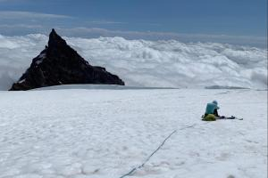 Mike, looking defeated and digging deep at Ingraham Flats, with Little Tahoma in the distance