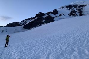 Approaching the North Ridge at day break, with the ice cliff looming above