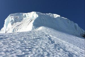 Looking up at the crux ice cliff