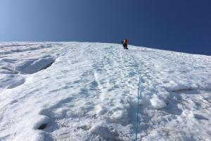 Eddie striking out on his first steep snow lead