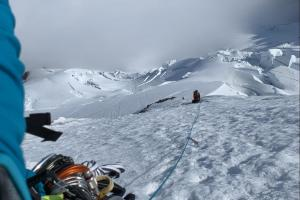 Looking back as Mike belay's Eddie above the ice crux