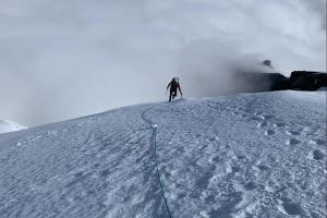 Mike coming up the ridge to transition back into glacier travel mode